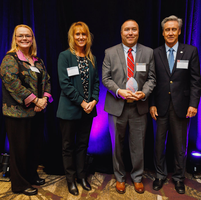 Omega Morgan's Erik Zander accepts the 2019 Supply Chain Award from Bechtel