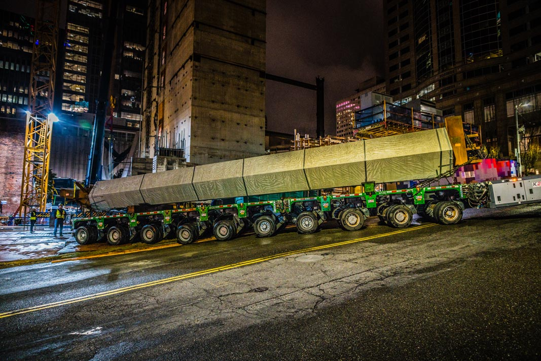 Omega Morgan SPMT delivering a column on a steep grade in downtown Seattle Washington at night