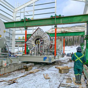 Omega Morgan's 250-ton gantry system being watched by of the specialized transportation crew members as it lifts heavy equipment into place in Chetwynd, BC
