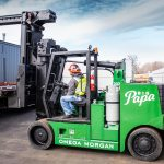 """Big Papa"", a Hoist FR 40/60 forklift, being used to unload metal fabrication equipment by the Omega Morgan Machinery Moving team"