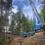 bridge being lifted by an Omega Morgan 500-ton leibherr crane in Port Angeles Rainforest