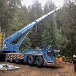 Omega Morgan Sarens 500-ton leibherr crane preparing to fly a PC-88 Komatsu excavator across a ravine in Port Angeles Rainforest