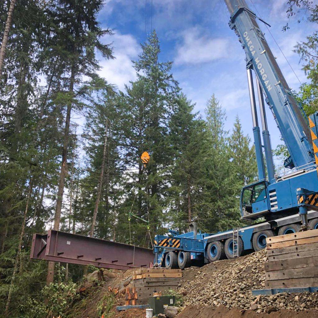 Omega Morgan 500-ton leibherr crane lifting a bridge in Port Angeles Rainforest
