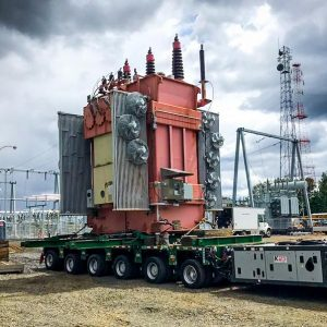 a fully-dressed transformer on top of a 6-1 line SPMT trailer in Portland at a Portland General Electric Substation
