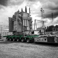 deselected thumbnail button of a fully-dressed transformer for Portland General Electric loaded onto a 6-1 line self propelled modular trailer in Portland, Oregon