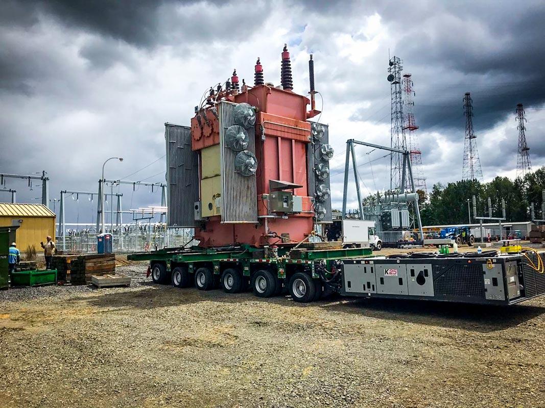 a fully-dressed transformer for Portland General Electric loaded onto a 6-1 line self propelled modular trailer in Portland, Oregon