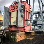 a fully dressed transformer ready to be moved at Portland General Electric substation