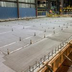 concrete poured by Omega Morgan millwright and industrial team to support a new rebar storage table