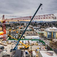 selected thumbnail button of aerial view of the Big Red Tower Crane dismantle with Omega Morgan mobile cranes onsite in Downtown Seattle Washington