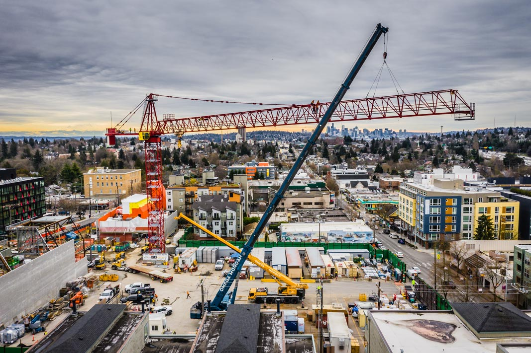 aerial view of the Big Red Tower Crane dismantle with Omega Morgan mobile cranes onsite in Downtown Seattle Washington