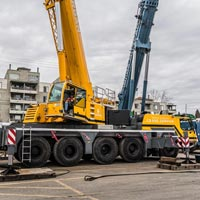 selected thumbnail button of yellow Omega Morgan mobile crane onsite in Seattle