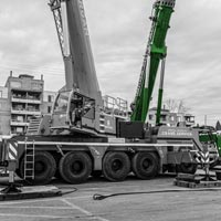 deselected thumbnail button of yellow Omega Morgan mobile crane onsite in Seattle