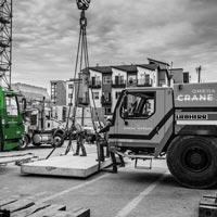 deselected thumbnail button of a construction worker near Omega Morgan mobile cranes in downtown Seattle Washington