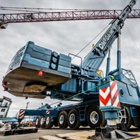 selected thumbnail button of Omega Morgan mobile crane onsite for dismantling a large tower crane known as