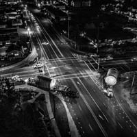 deselected thumbnail button of Omega Morgan specialized transportation rigs turning at an intersection at night