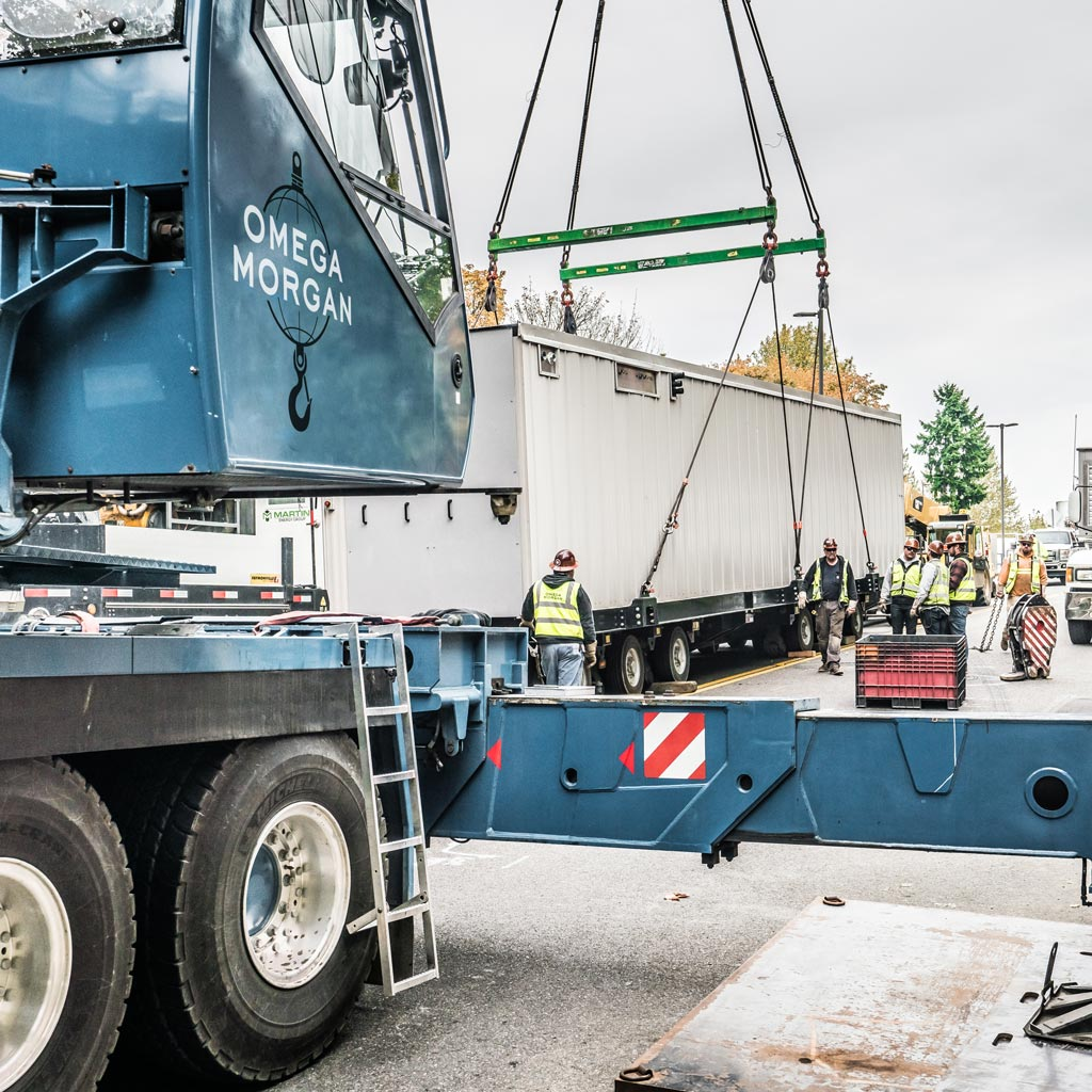 Omega Morgan Sarens crane lifting new energy equipment near Seattle, Washington