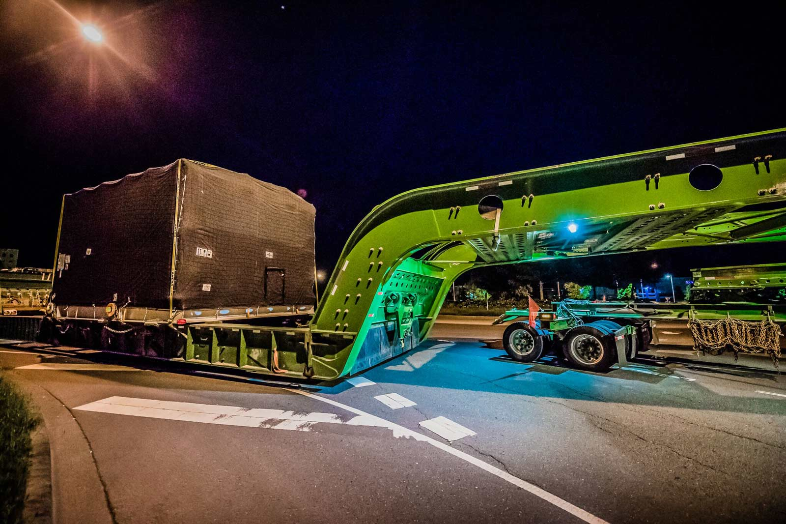 compressor package on a 150-ton dual lane trailer on the road at night