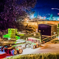 full color thumbnail of 150-ton dual lane trailer carrying compressor package on road in British Columbia at night