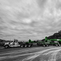 black and white and green thumbnail of omega morgan trailer with compressor package loaded and parked