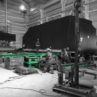 black and white and green thumbnail of compressor package in building onsite
