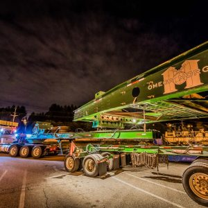 Omega Morgan 150-ton dual lane trailer at night