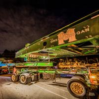 full color thumbnail of Omega Morgan 150-ton dual lane trailer at night