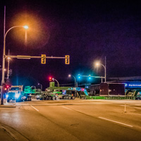 full color thumbnail of 150-ton dual lane trailer carrying compressor package turning at an intersection in British Columbia at night