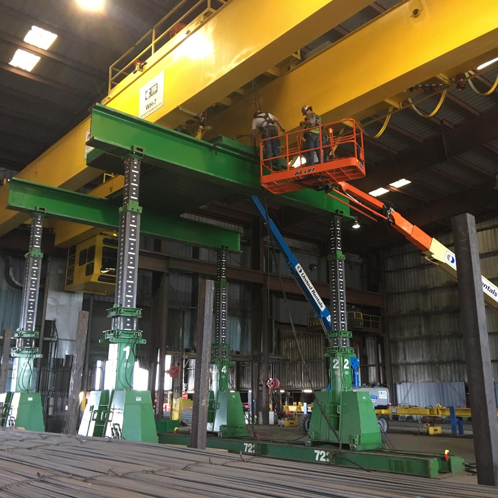Omega Morgan machinery moving crews lifting an overhead crane at a Mcminville, Oregon facility