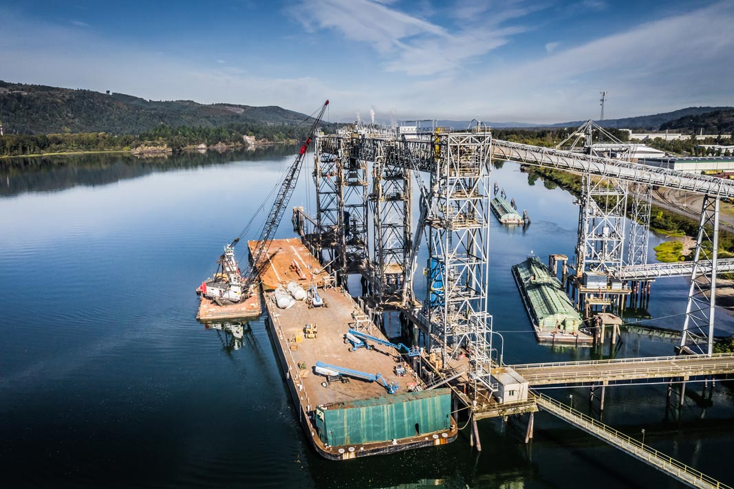 View from the sky looking down at the dock where Omega Morgan millwrights working on Spout number one at the Kalama international grain terminal