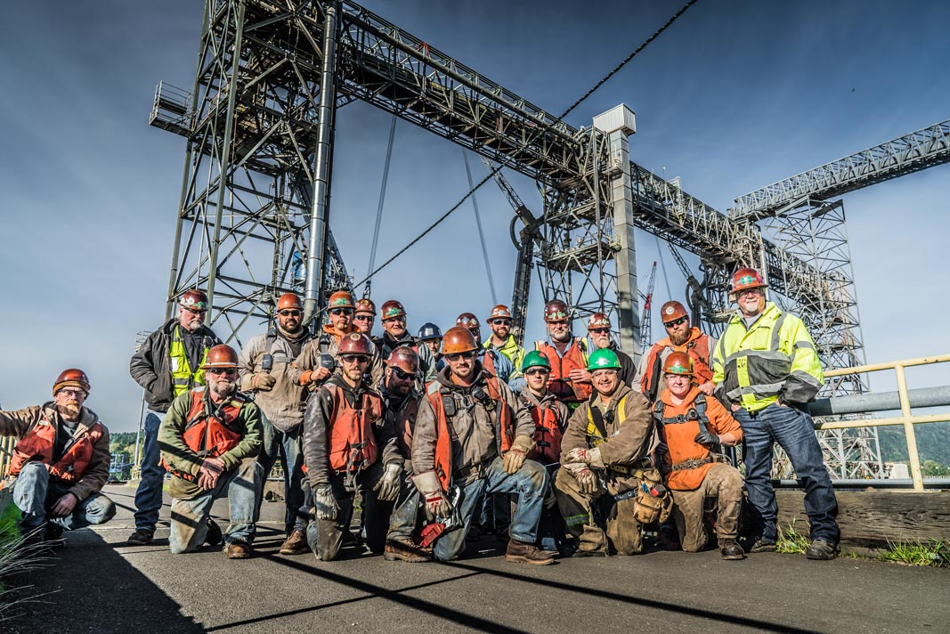 Omega Morgan millwright crew poses on the dock in Kalama, Washington where they worked on a grain spout