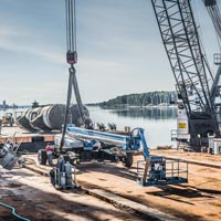 selected thumbnail button of Omega Morgan Millwright crew and equipment on the dock at Kalama Export