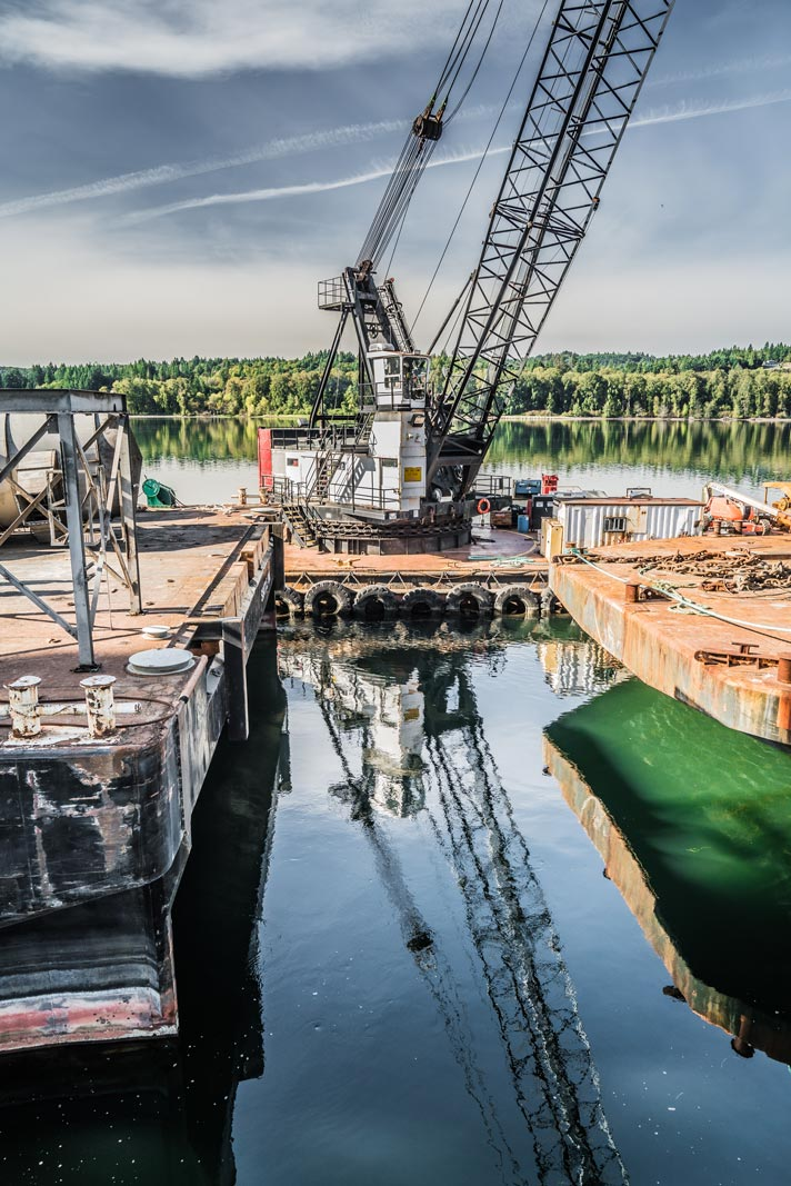 Omega Morgan repair barge at Kalama Export reflecting in the water below the dock where a grain spout is being repaired