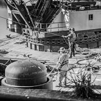 deselected thumbnail button of Two omega Morgan crew members on the dock working on fixing the broken spout number one at Kalama Export, an international grain terminal