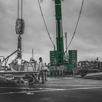 deselected thumbnail button of Omega Morgan crane services crew working in front of Leibherr crane onsite at Puget Sound Energy on a cloudy day