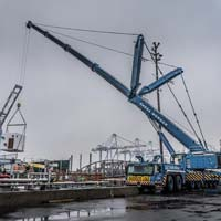 selected thumbnail button of An Omega Morgan Crane Services Leibherr L T M 1400-7.1 with 308,000 pound counter weight and y-guy lifting a load at puget sound energy