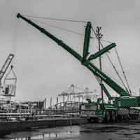 deselected thumbnail button of An Omega Morgan Crane Services Leibherr L T M 1400-7.1 with 308,000 pound counter weight and y-guy lifting a load at puget sound energy