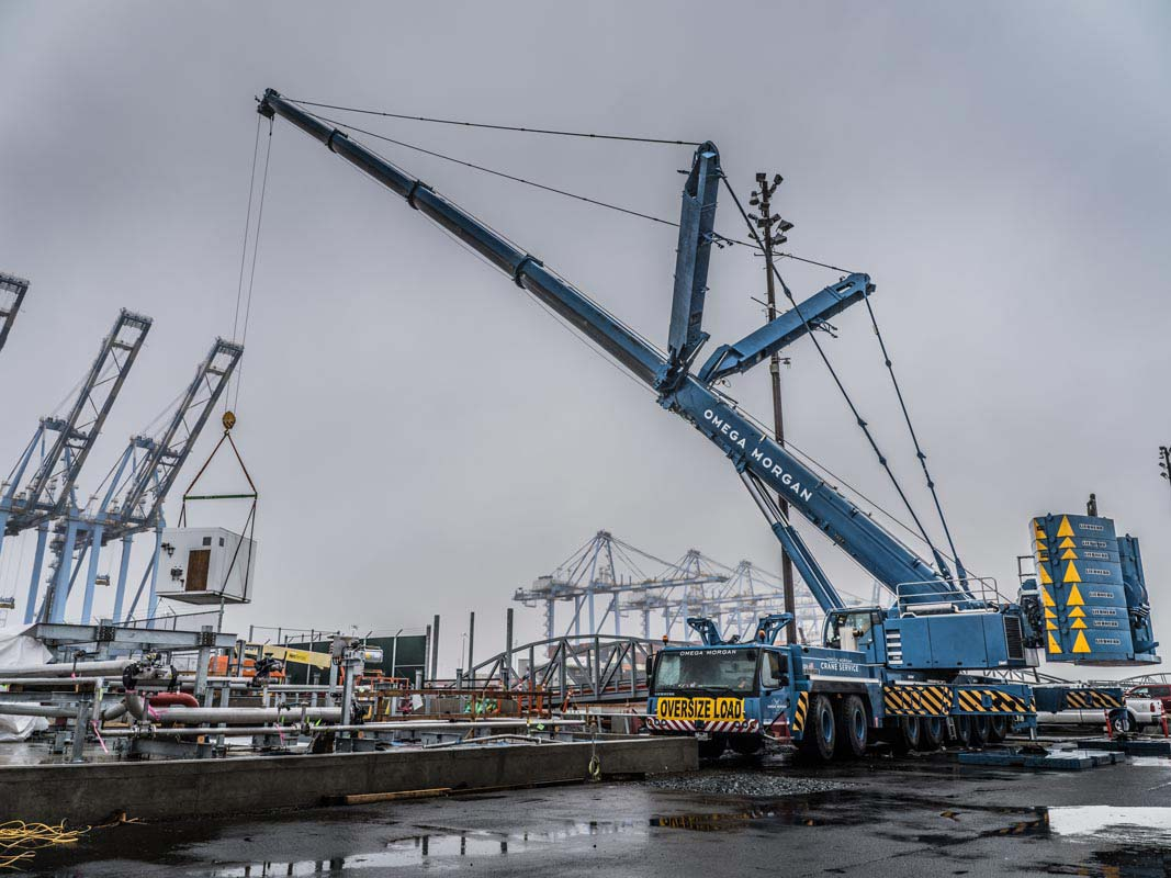 An Omega Morgan Crane Services Leibherr L T M 1400-7.1 with 308,000 pound counter weight and y-guy lifting a load at puget sound energy