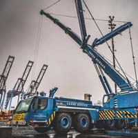 selected thumbnail button of An Omega Morgan Crane Services Leibherr L T M 1400-7.1 with 308,000 pound counter weight and y-guy extended and ready for a load on a dark cloudy day