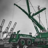 deselected thumbnail button of An Omega Morgan Crane Services Leibherr L T M 1400-7.1 with 308,000 pound counter weight and y-guy extended and ready for a load on a dark cloudy day