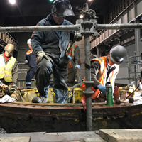 full color thumbnail of Omega Morgan millwright crew working on a steel mill ladle turret replacement for cascade steel mills