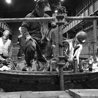 black and white thumbnail of Omega Morgan millwright crew working on a steel mill ladle turret replacement for cascade steel mills