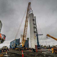 full color thumbnail of two cranes setting a coldbox upright