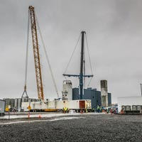 full color thumbnail of cold box on its side with two cranes ready to lift and set it in place