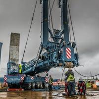 full color thumbnail of crews setting up blue omega morgan crane