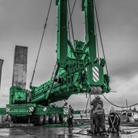 black and white and green thumbnail of crews setting up blue omega morgan crane