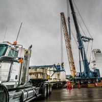 full color thumbnail of two cranes preparing to lift a cold box