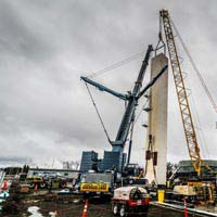 full color thumbnail of cranes lifting and setting a cold box into place