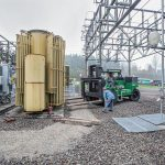 Omega Morgan machinery moving team using their Riggers 120 forklift to lift a PGE transformer at a transformer technologies substation