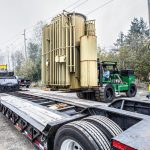 PGE transformer being loaded onto a trailer by a Riggers 120 forklift, operated by the Omega Morgan machinery moving team