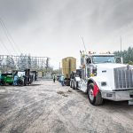 PGE transformer fully transferred to the trailer by the Omega Morgan machinery moving team using their Riggers 120 forklift
